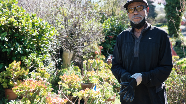 Charles Herring in front of some of the plants he grew