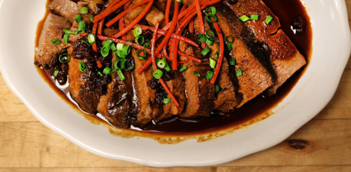 Ancho adobo-braised beef brisket with carrots and raisins is one of the dishes in Comal's Mexican Passover meal. Photo: Comal