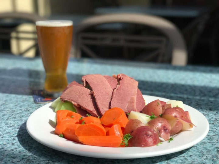 Corned beef and cabbage with red potatoes and carrots with a pint of beer at Buttercup.