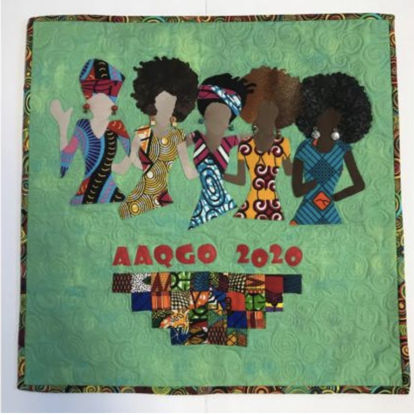 A quilt depicting a group of five women and the words AAQGO 2020
