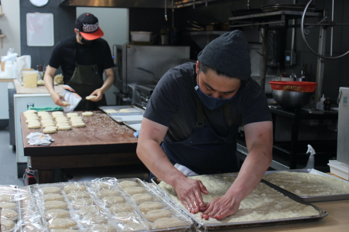 Albert Ok and Kelvin Choy prepare focaccia and buns for sandwiches. Credit: @brokeasscooks