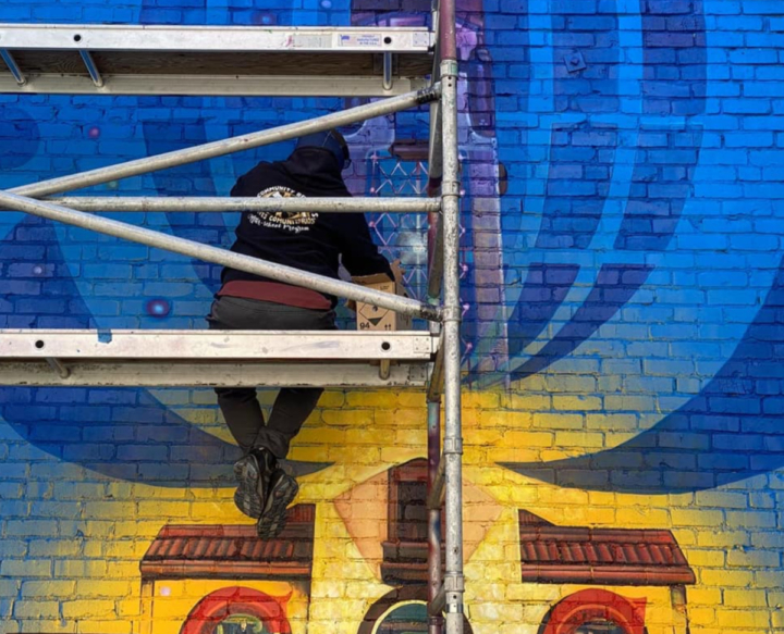 Artists David Burke and Pancho Pescador are responsible for the murals outside the Alameda location of Coffee Cultures. Photo: David Burke