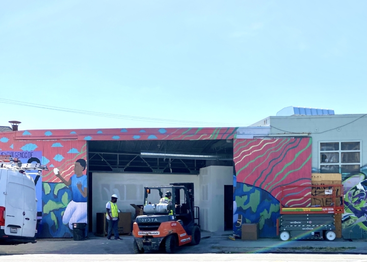 Workers operate a fork lift at an upcoming ghost kitchen location in Longfellow, Oakland.